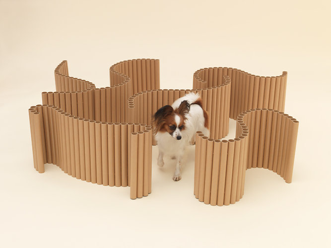 Muji's Architecture for Dogs includes Shigeru Ban's structure for Papillons made from used plastic wrap tubes can transform from a maze to a bed to even a chair or a table for yourself