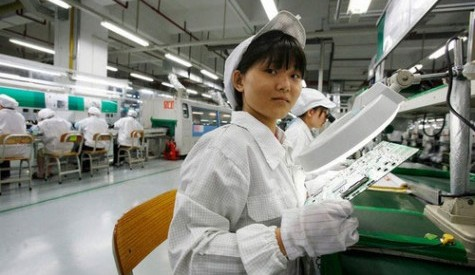 Foxconn will replace plant workers like this with robots beginning in 2012