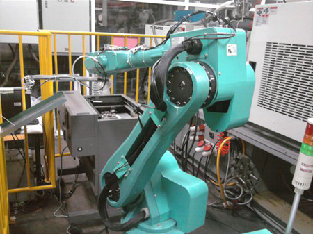 30,000 industrial robots like this one will be installed in Foxconn factories by the end of 2012
