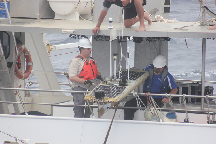 Liquid Robotics' Wave Glider robot Papa Mau finally completes it's 9000-mile trip as it is hoisted aboard the Liquid Robotics' chase ship