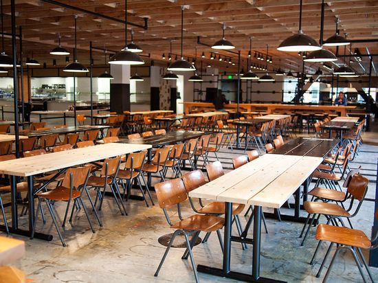 Facebook's Epic cafe is full of reclaimed furniture and custom pieces, all which create a post-industrial space that's reminiscent of a schoolhouse or factory