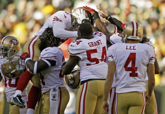 49ers field goal kicker David Akers celebrates with teammates after making a 63-yard field goal and tying an NFL record