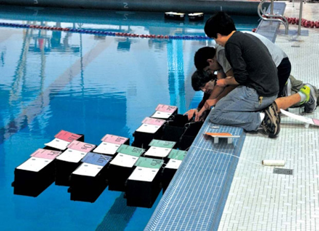 Penn GRASP Lab engineering students tinker with floating robotic shipping containers a.k.a. TEMP at the Penn swimming pool