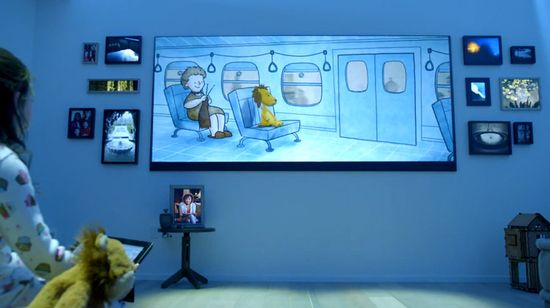 And here we see the saddest moment. A little girl supposedly ignores her adorable, plush lion for a poor facsimile on a gigantic TV, surrounded by a dozen digital picture frames