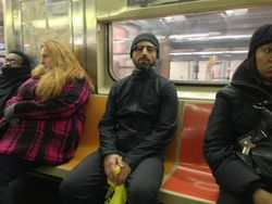 Google Co-Founder Sergey Brin wears a pair of Google Glass AR glasses in a bus