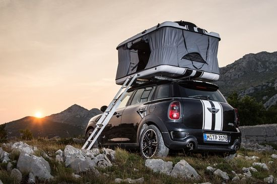 The roof top camper of the Mini Countryman All4Camp in the open position waiting for the sun to set.  Photo by BMW Group