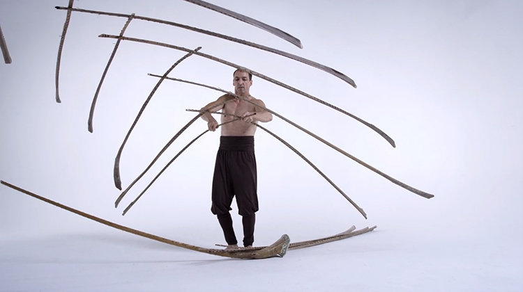 Kinetic structure balanced on a feather 4