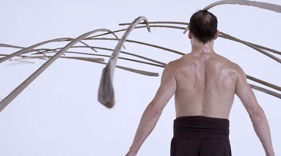 Kinetic structure balanced on a feather 5