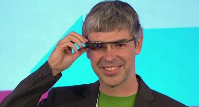 Google CEO & Co-Founder Larry Page wears a pair of Google Glass AR glasses