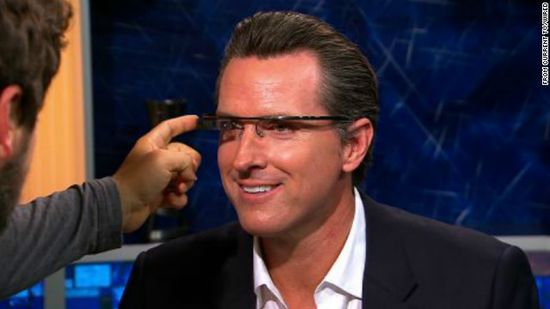 California Lieutenant Governor Gavin Newsom, and former mayor of San Francisco, tries the glasses on Current TV