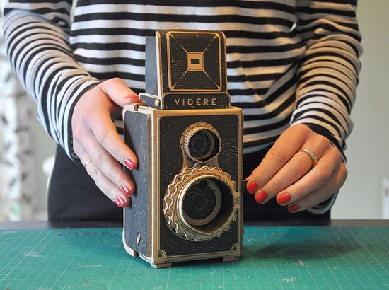The Videre is a pinhole camera by Kelly Angood, decorated with an intricate, cardboard twin lens reflex camera body (so it looks like a TLR, but it's not) 3