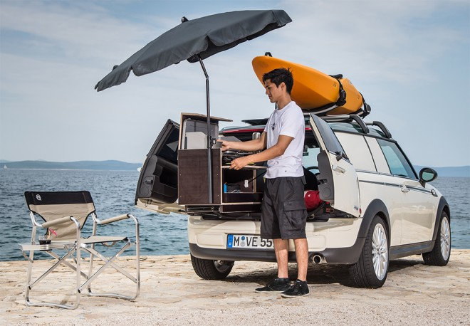 The Mini Club Van Camper has roof racks that store the gear, a built in fridge cools the beer. Photo by BMW Group