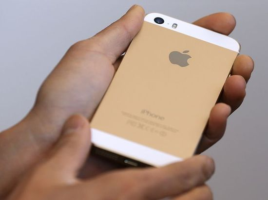 A person holds the new iPhone 5S during an event at the Apple campus on Sept. 10 in Cupertino, Calif