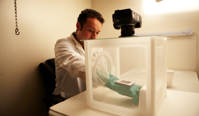 A scientist testing the chemical compounds. Image courtesy of Olfactor Laboratories