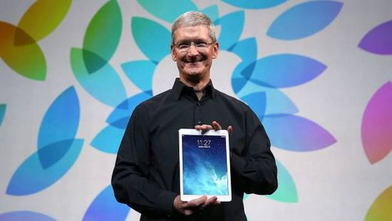 Apple CEO Tim Cook holding the new 1-lb iPad Air