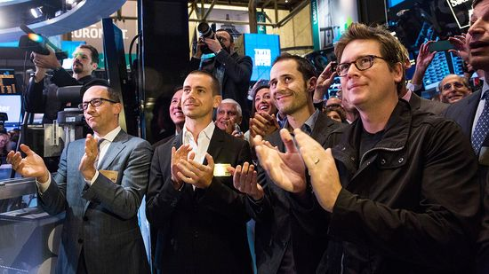 (L-R) Twitter CEO Dick Costolo, Twitter cofounder Jack Dorsey, Twitter cofounder Evan Williams, and Twitter cofounder Biz Stone applaud as Twitter rings the opening bell at the NYSE