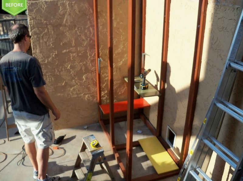 Here is Tom working on the steps from the guesthouse to the top of the kitty enclosure