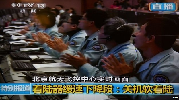 Scientists celebrated at the control centre in Beijing after Chin's first lunar rover touched down