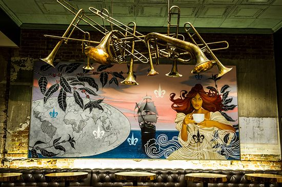 A mix of local and Atlanta-based artists created a mural, wrought iron chandeliers, and a hanging mobile of brass jazz instruments