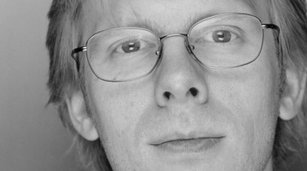 Id Software's John Carmack is pushing hard to make VR headsets a part of every gamer's standard equipment