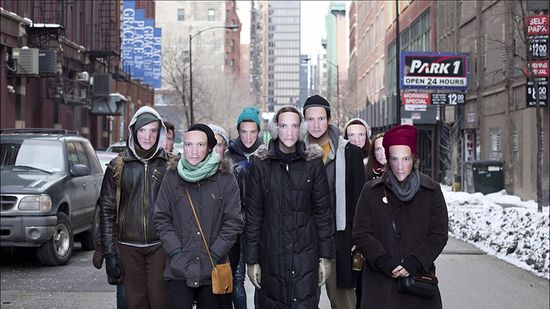 This group of Chicagoans wear masks of Chicago artist Leo Selvaggio face