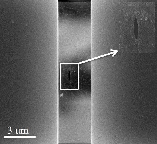 An electron microscope image shows a pre-crack in a suspended sheet of graphene used to measure the overall strength of the sheet - The Nanomaterials, Nanomechanics and Nanodevices Lab-Rice University