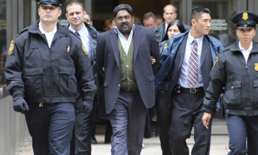 Raj Rajaratnam, Galleon Group fund manager and co-founder, is arrested by U.S. marshals at his office in Manhattan in October 2009 for alledged violations of fraud and insider trading laws