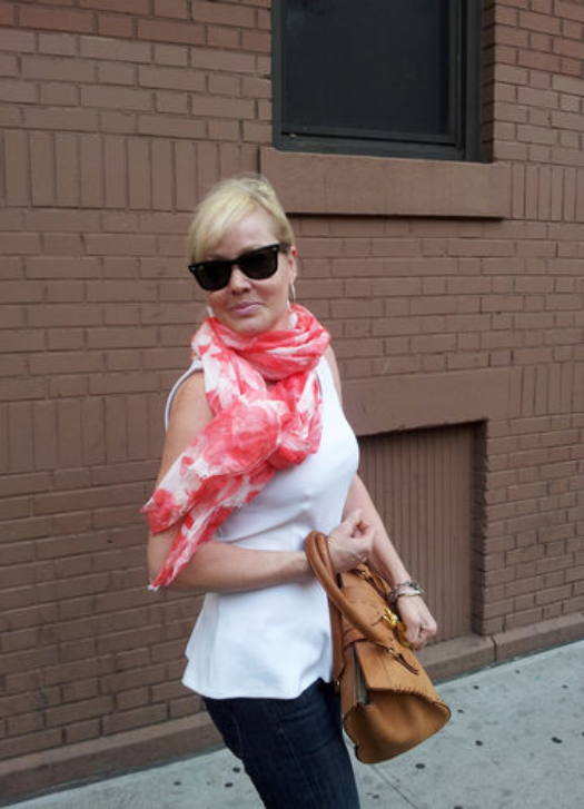 A svelte Chiesi, wearing a white sleeveless peplum top, jeans and pink and white scarf, as she left a residence she shares with other newly freed prisoners in May 2014