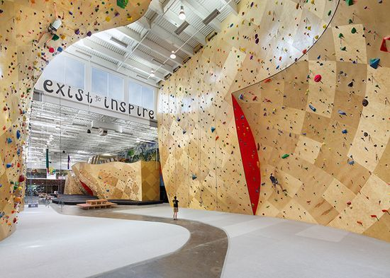 Brooklyn Boulders Somerville gives us a whole new definition of open offices including this incredible climbing wall
