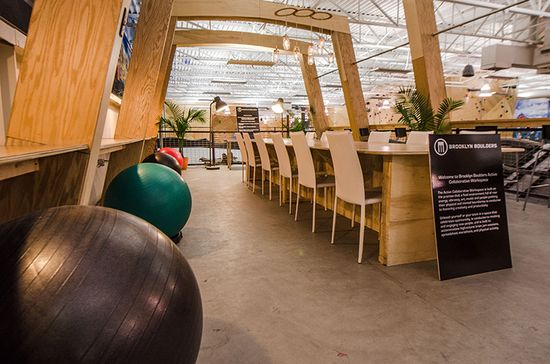 Brooklyn Boulders Somerville's co-working space is planted in the middle of a 40,000-square-foot climbing facility that is located on top of a 120-foot long and 22-foot high climbing wall