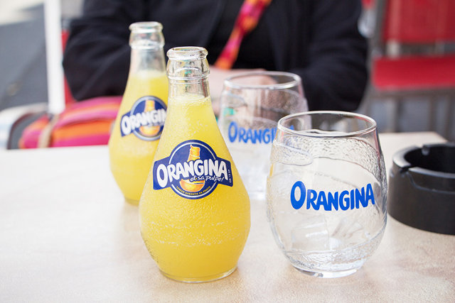 Orangina Juice is packaged in tear glass-shaped glass containers to make their orange juice standout