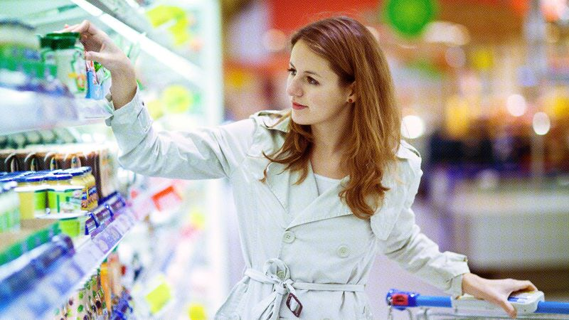 A shopper inspecting product packages while shopping