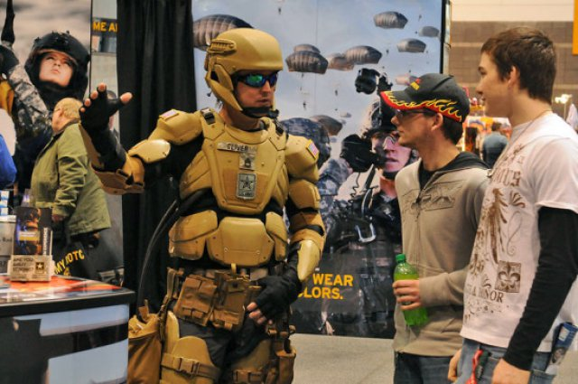 Sgt. 1st Class Matthew Oliver suits up in a futuristic combat uniform with a Tactical Assault Light Operator Suit-like look at the 2012 Chicago Auto Show