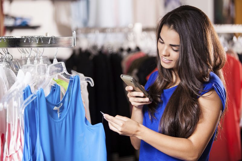 Consumers using their smartphones to check prices and product recommendations while in stores