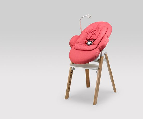 The original chair was meant for tots who had reached six months of age, but the new model can seat even a newborn baby who can't yet hold up its own head