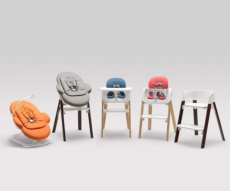 They added two hinged legs to the seat, in addition to the traditional coil, to make the bouncer's motion gentler