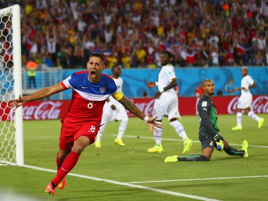 The United States' Clint Dempsey reacts after scoring his team's first goal past goalkeeper Ghana's Adam Kwarasey during the 2014 FIFA World Cup Brazil