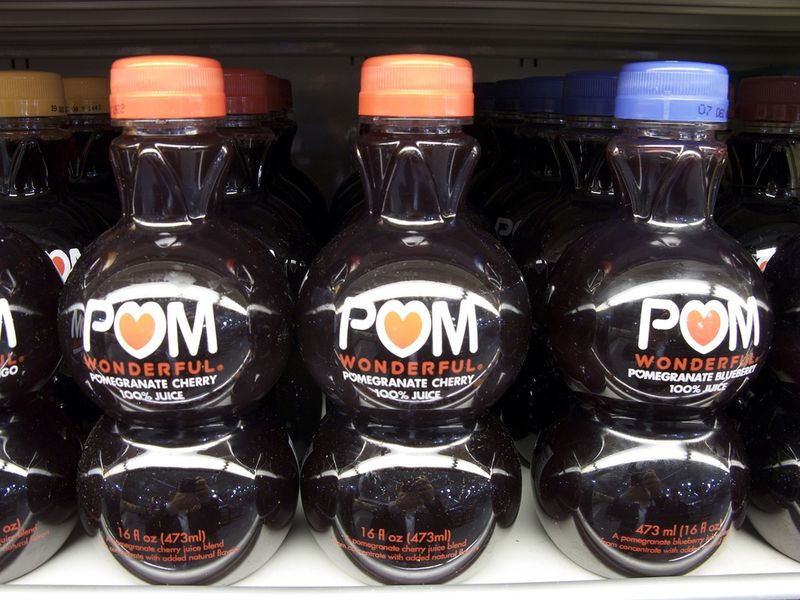 POM Juice uses clear spherical glass containers to accentuate their pomegranette juice to consumers