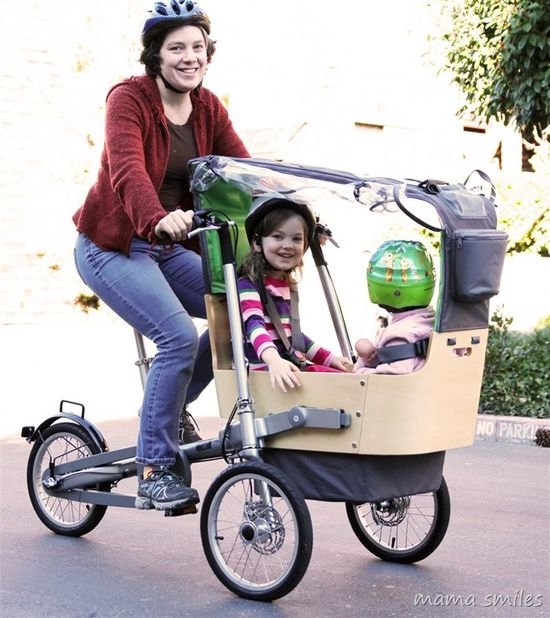 The Taga bike is designed for portability and ability to transport two small children simultaneously in a protective carrier