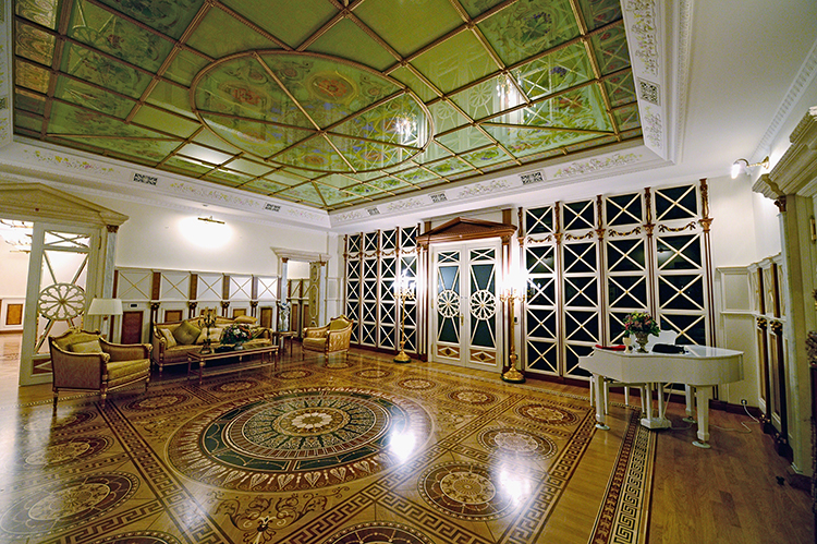 The sitting room of the Ukrainian Presidential Palace is as large a small formal ball room and includes a white grand piano