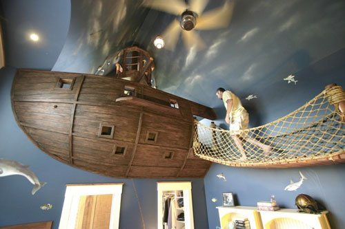Kids room decorated with a fantasy ceiling and boat bed