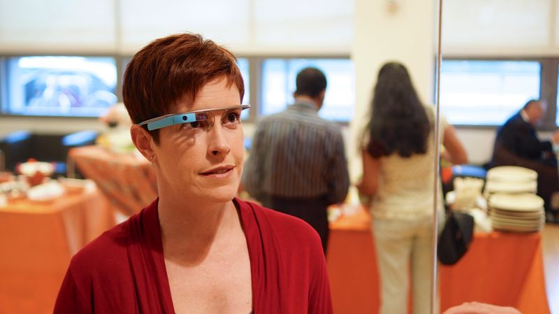 Google Glass are augmented reality glasses that display real-time information in a smartphone-like hands-free format