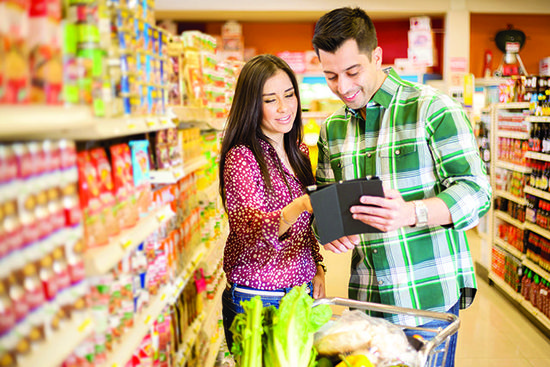 Millennials out shopping use mobile devices to check product reviews and prices at other stores