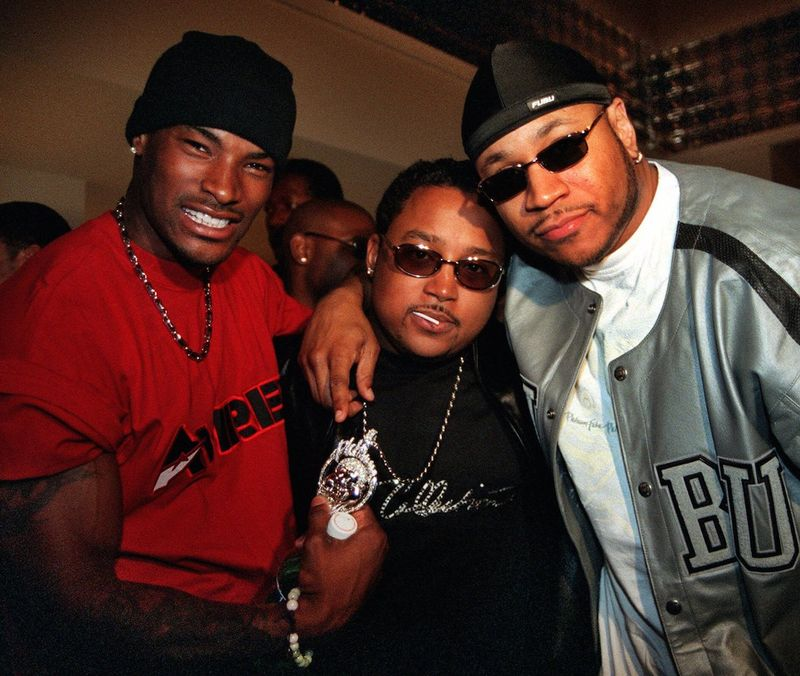 Daymond John (center) with model Tyson Beckford (left) and rapper LL Cool J at a FUBU event in 2000