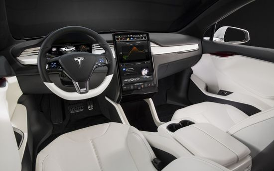 Tesla Model X all-electric SUV interior showing touchscreen console 1