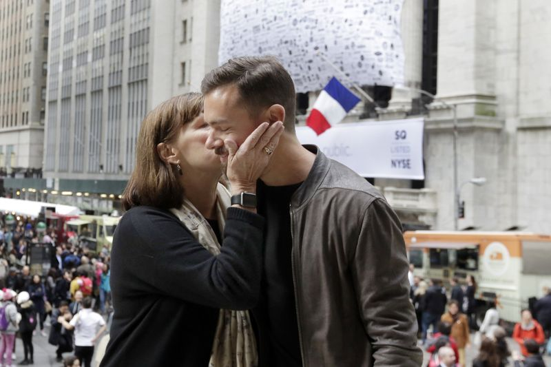 Square CEO Jack Dorsey gets a birthday kiss from his mother, Marcia Dorsey, before his company's IPO at the New York Stock Exchange, Thursday, Nov. 19, 2015