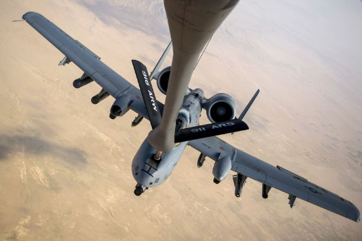 An A-10 Thunderbolt II receives fuel from a KC-135 Stratotanker July 10, 2014, over Eastern Afghanistan. The A-10 is assigned to the 303rd Expeditionary Fighter Squadron, Bagram Airfield, Afghanistan