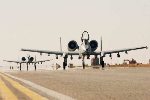 Two A-10C Thunderbolt IIs, flown by Lt. Col. Michael Millen, 354th Expeditionary Fighter Squadron commander, and Col John Cherrey, 451st Expeditionary Operations Group commander, taxi down the runway
