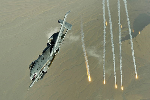 An A-10 Thunderbolt II deploys flairs over Afghanistan Nov. 12, 2008. A-10s provide close-air support to ground troops in Afghanistan and Iraq
