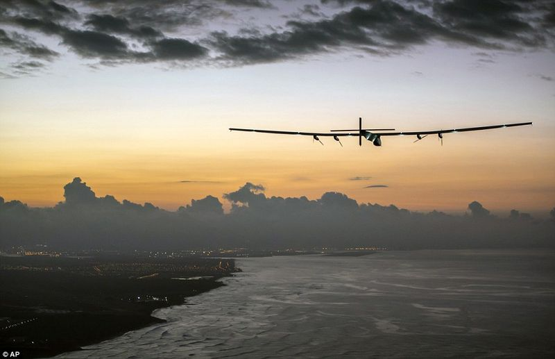 Coming into land, Solar Impulse 2, powered by the sun's rays and piloted by Andre Borschberg, approaches Kalaeloa Airport near Honolulu after a 120-hour voyage from Nagoya, Japan